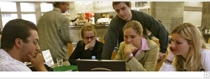 Students discussing in the cafeteria.